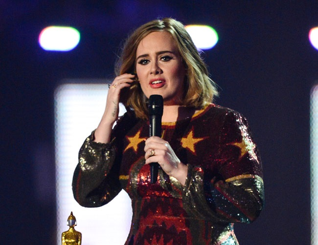 Adele wants to stop swearing